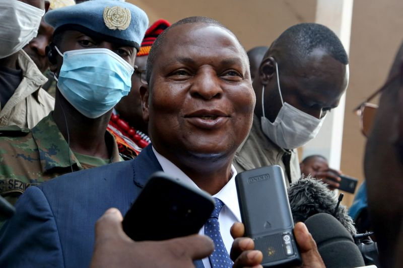 FILE PHOTO:  Central African Republic President Faustin Archange Touadera addresses the media outside a polling station, after casting his ballots during the Presidential and legislative elections at a polling station in Lycee Boganda, Bangui