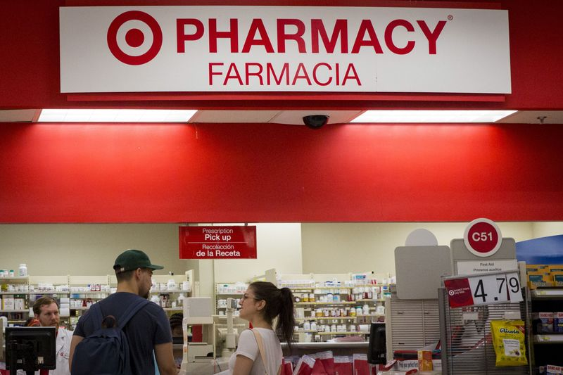 FILE PHOTO: Customers wait in line in the pharmacy department at a Target store in the Brooklyn borough of New York