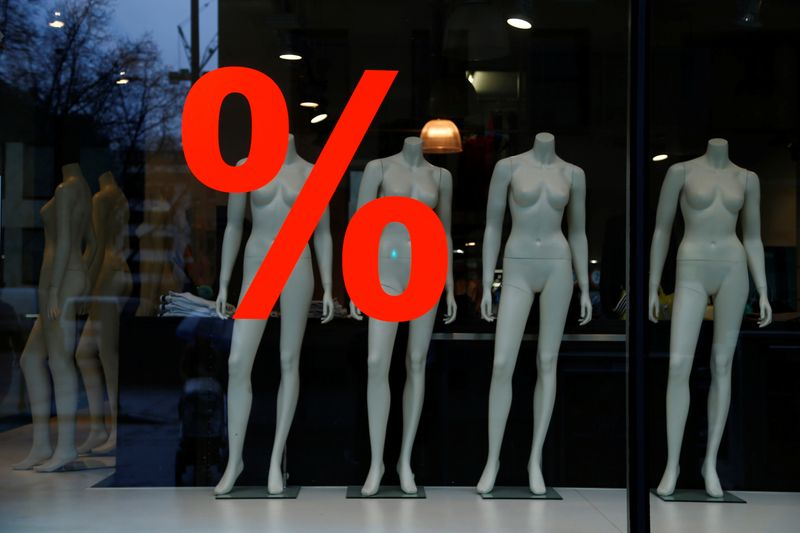 Discount sign is displayed in a clothing store window in Frankfurt