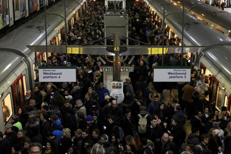 FILE PHOTO: General view of busy Earls Court tube station in London, Britain