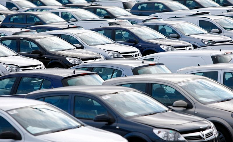 File photograph shows new Vauxhall cars standing outside the company's factory in Ellesmere Port, northern England