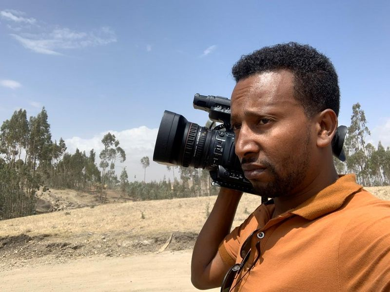 A photograph taken from the family album shows Reuters cameraman Kumerra Gemechu as he arrives to cover a breaking news assignment in Bishoftu