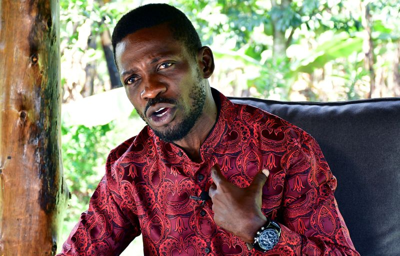 FILE PHOTO:  Ugandan opposition presidential candidate Robert Kyagulanyi, also known as Bobi Wine, talks during an interview with Reuters at his home in Magere