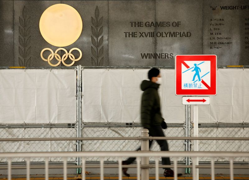 Olympic rings are seen outside the National Stadium in Tokyo