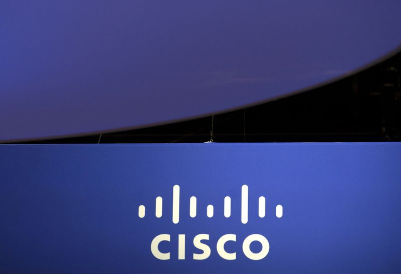 FILE PHOTO: The Cisco Systems logo is seen as part of a display at the Microsoft Ignite technology conference in Chicago