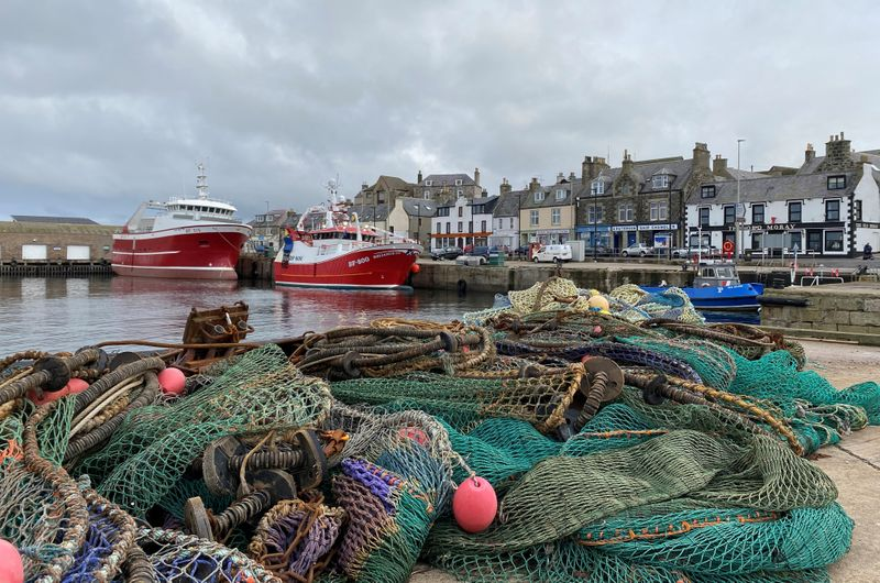 FILE PHOTO: Fishing boat sits docked in Macduff, Aberdeenshire