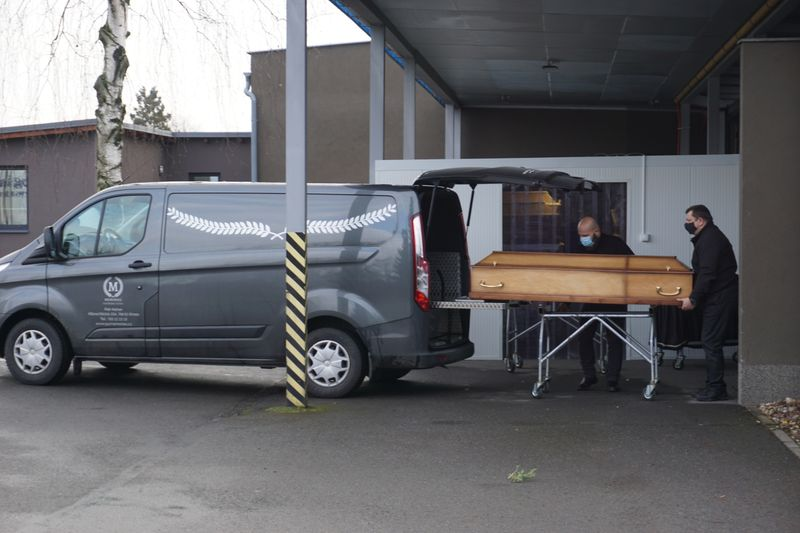 Funeral workers brings a coffin of a person who passed away due to coronavirus disease (COVID-19)  at crematory in Ostrava