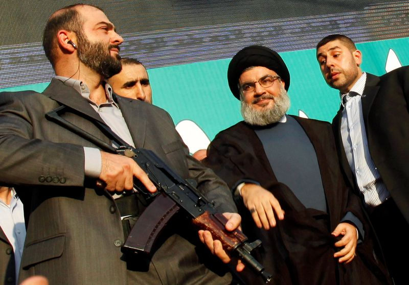 FILE PHOTO: Lebanon's Hezbollah leader Sayyed Hassan Nasrallah greets his supporters at an anti-U.S. protest in Beirut's southern suburbs