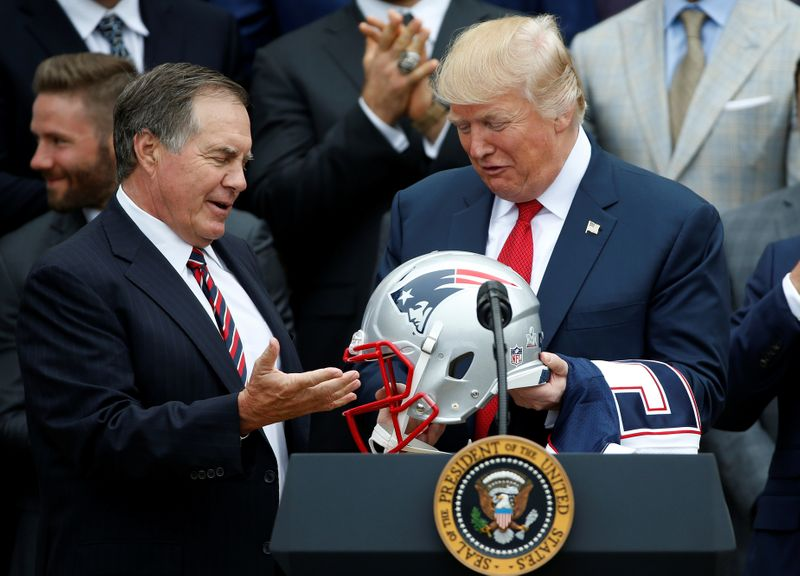 U.S. President Donald Trump holds a New England Patriots helmet as Coach Bill Belichick and CEO of the New England Patriots Robert Kraft, watch during an event honoring the Super Bowl champion team at the White House in Washington