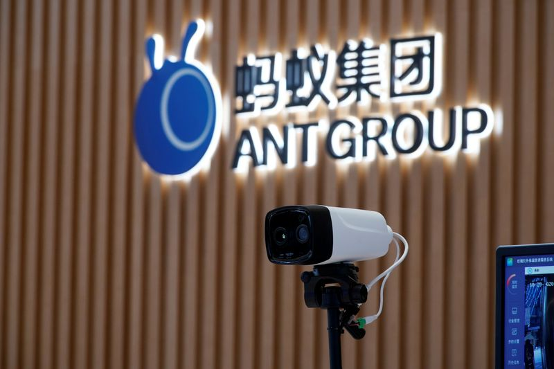 FILE PHOTO: A thermal imaging camera is seen in front of a logo of Ant Group at the headquarters of Ant Group, an affiliate of Alibaba, in Hangzhou