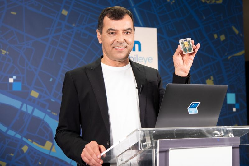 Handout image of Mobileye CEO Amnon Shashua holding a lidar chip being developed by the self-driving car firm