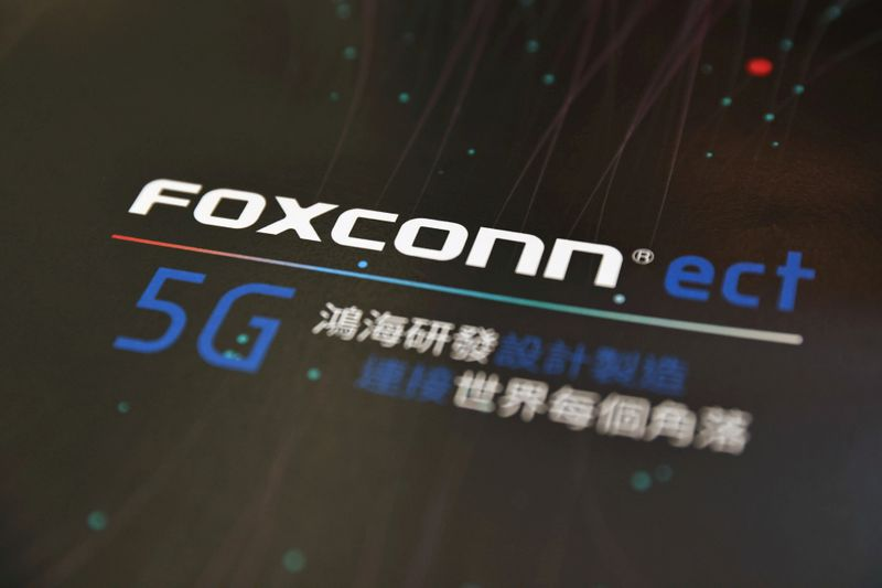 FILE PHOTO: A poster with a logo of Foxconn is seen at the IEEE Global Communications Conference in Taipei