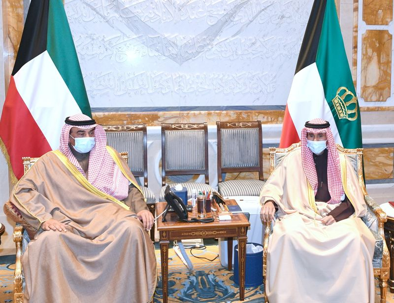 Kuwait's Prime Minister Sabah al-Khalid al-Sabah meets with the emir, Sheikh Nawaf al-Ahmed al-Sabah to present the resignation of his cabinet, in Kuwait City