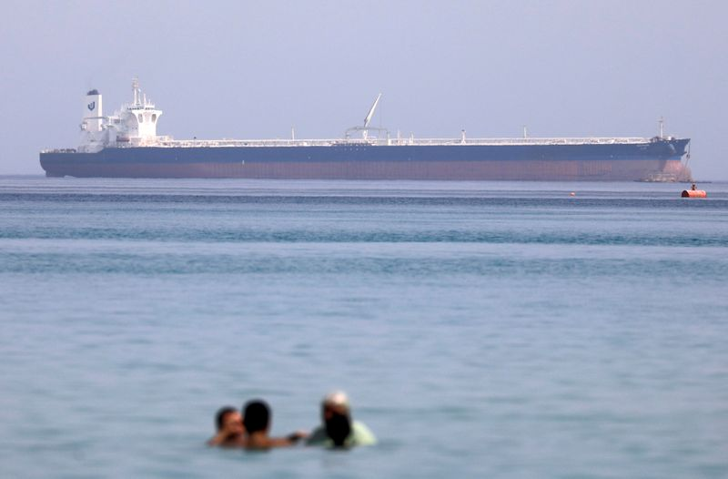 FILE PHOTO: A container ship crosses the Gulf of Suez towards the Red Sea before entering the Suez Canal, in El Ain El Sokhna