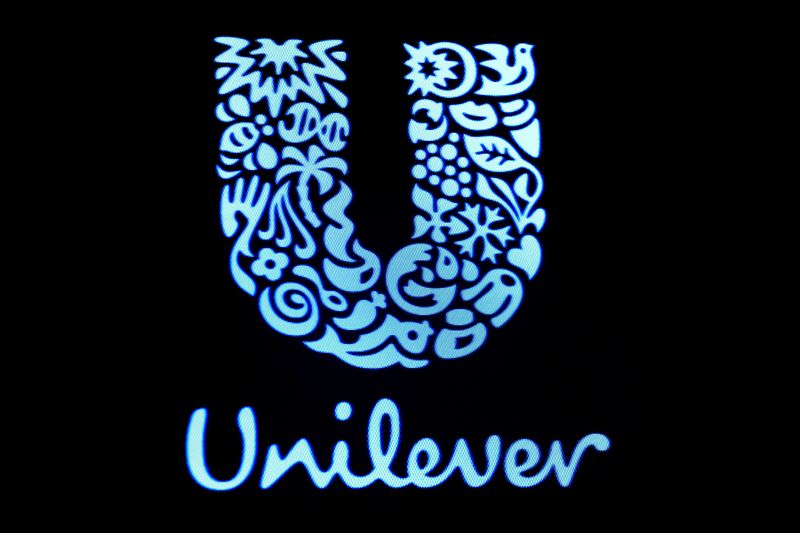 FILE PHOTO: The company logo for Unilever is displayed on a screen on the floor of the NYSE