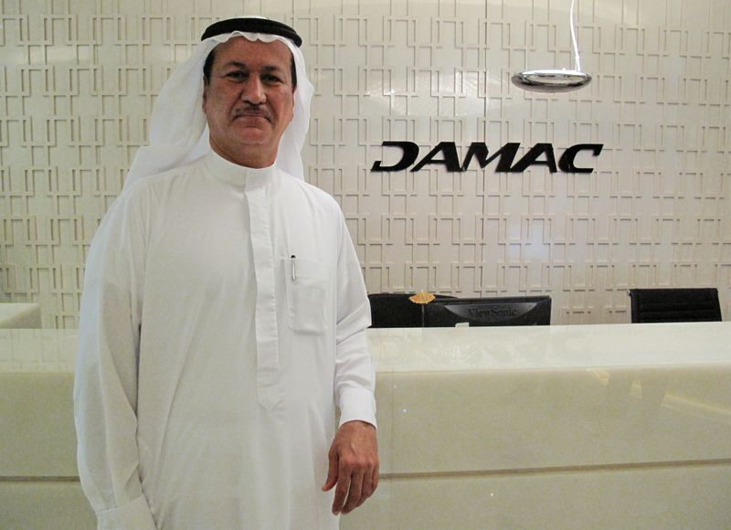 Hussain Sajwani, founder and chairman of Dubai's DAMAC Properties poses for the camera during an interview with Reuters at his office in Dubai