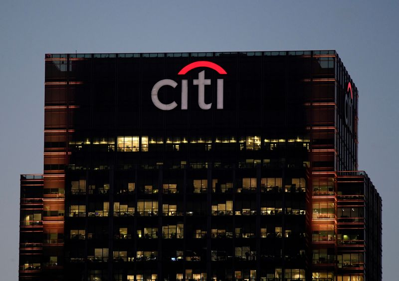 FILE PHOTO: Workers are seen in at Citibank offices in the Canary Wharf financial district in London