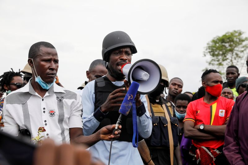 Ugandan opposition presidential candidate Robert Kyagulanyi, also known as Bobi Wine, speaks during the funeral of his driver Elijah Mukiibi,who he claims was killed by security forces, in the village of Bowa