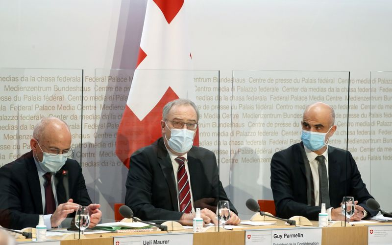 Swiss Interior Minister Alain Berset, President Guy Parmelin and Finance Minister Ueli Maurer attend a news conference in Bern