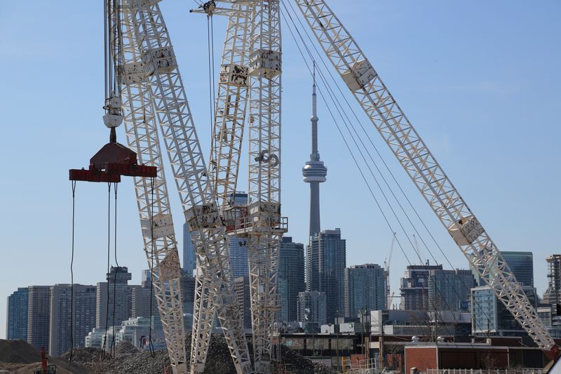 FILE PHOTO: The downtown skyline and CN Tower are seen past cranes in the waterfront area of Toronto