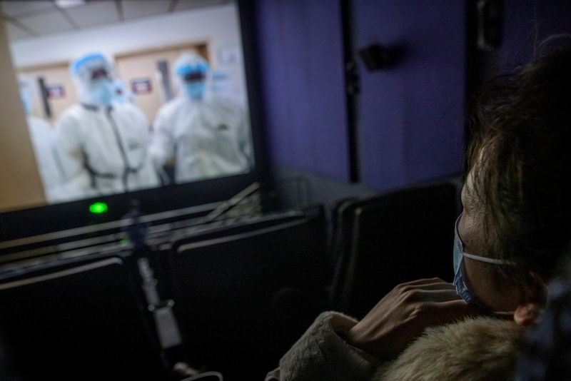 A woman watches the Chinese documentary