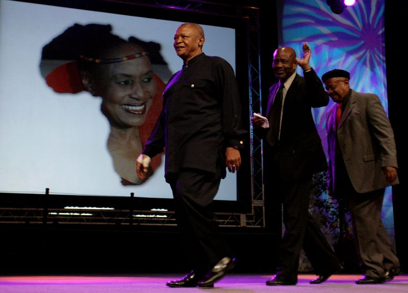 FILE PHOTO: South African trumpeter Masekela, who was once married to singer Makeba, leaves after paying tribute during MMakeba?s memorial service in Johannesburg