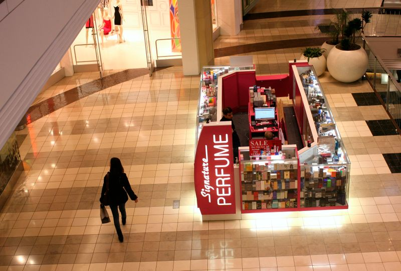 U.S. consumer spending decreases further, inflation creeps up