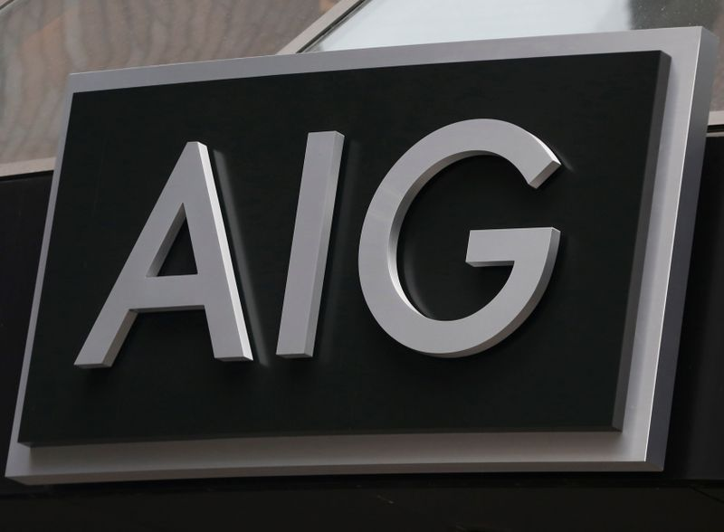 FILE PHOTO: A sign is displayed over the entrance to the AIG headquarters offices in New York's financial district