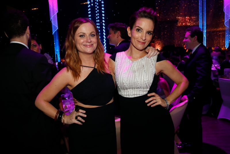 Amy Poehler and Tina Fey pose during the 67th Annual Primetime Emmy Awards Governors Ball in Los Angeles