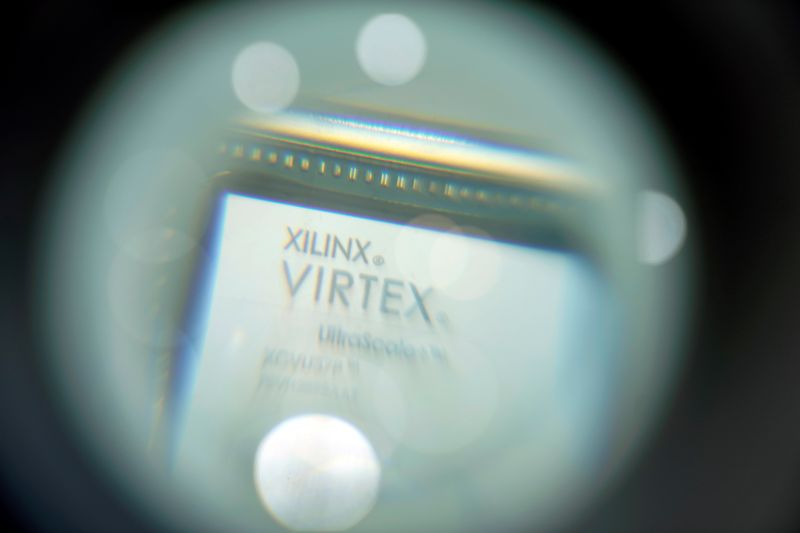FILE PHOTO: A chip of Xilinx is displayed through a magnifying glass during the China International Import Expo (CIIE), at the National Exhibition and Convention Center in Shanghai