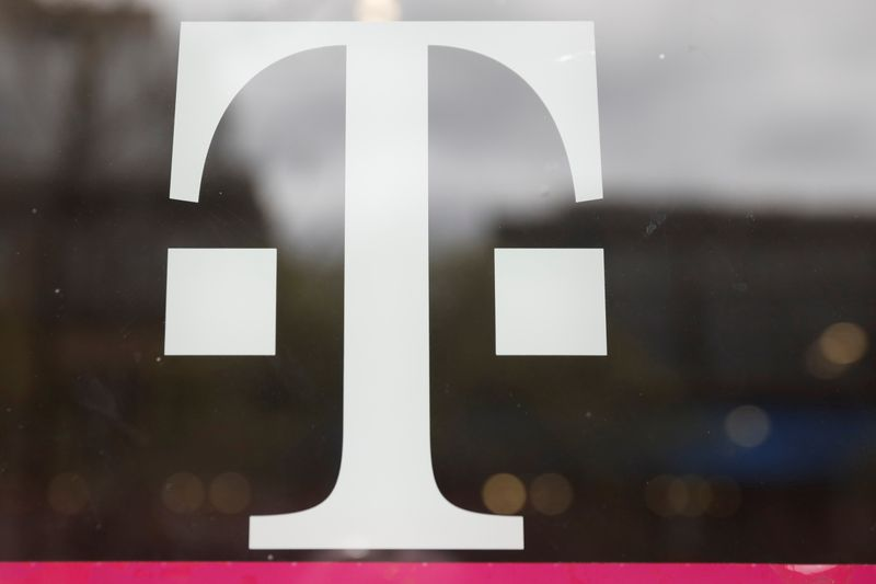 FILE PHOTO: A T-Mobile logo is seen on the storefront door of a store in Manhattan