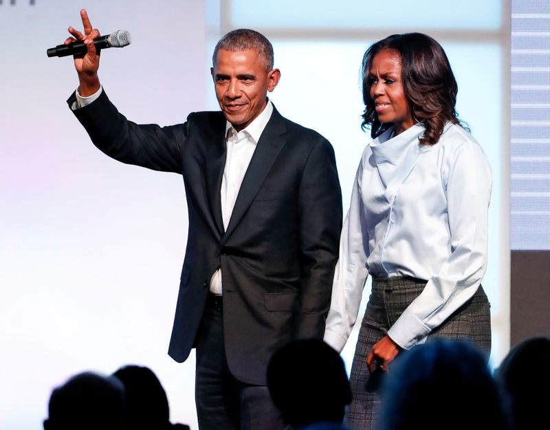 FILE PHOTO: Former U.S. President Barack Obama and former first lady Michelle Obama greet guests during the Obama Foundation Summit in Chicago