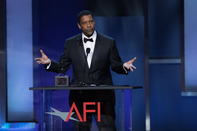 FILE PHOTO: Actor Denzel Washington accepts the 47th AFI Life Achievement Award at the gala honoring him in Los Angeles