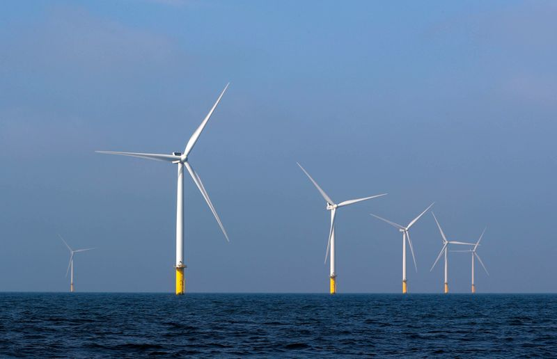 Power-generating windmill turbines are seen at the Eneco Luchterduinen offshore wind farm near Amsterdam