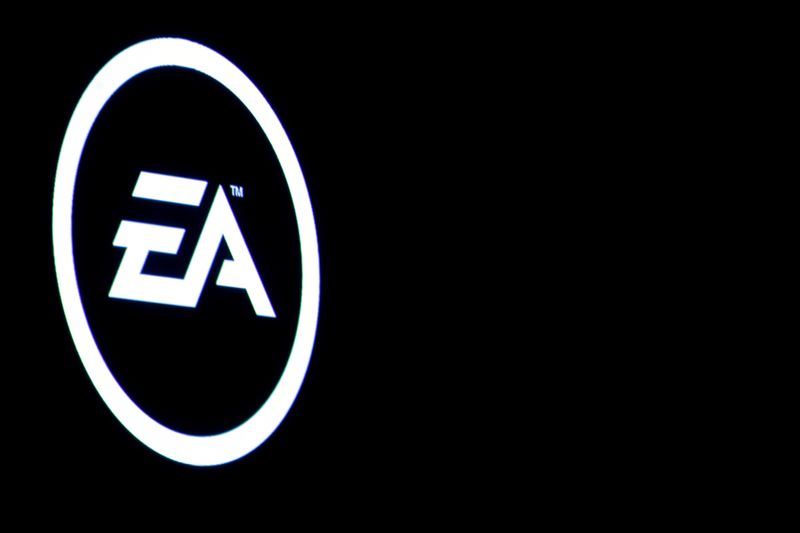 The Electronic Arts Inc., logo is displayed on a screen during a PlayStation 4 Pro launch event in New York