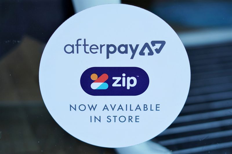 FILE PHOTO: A logo for the companies Afterpay and Zip is seen in a store window in Sydney