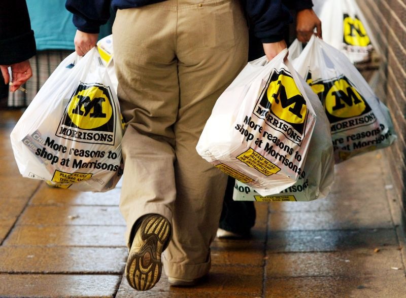 FILE PHOTO: A shopper leaves with her groceries at the Morrisons supermarket in Bradford City center