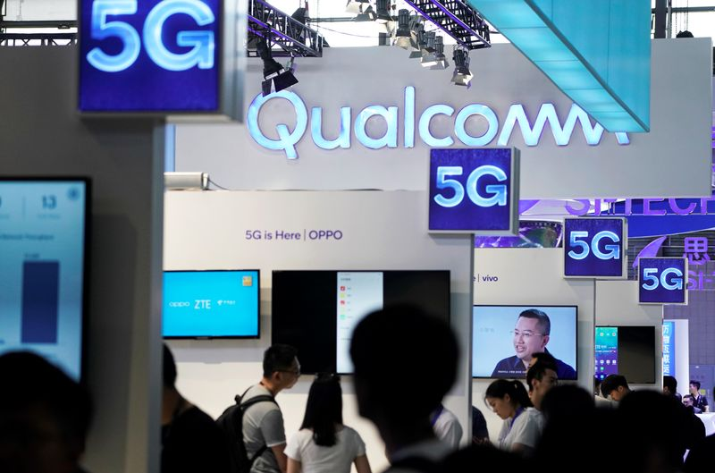 Signs of Qualcomm and 5G are pictured at Mobile World Congress (MWC) in Shanghai