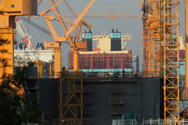 FILE PHOTO: Two large container ships and a tanker can be seen in construction in a ship yard close to Busan
