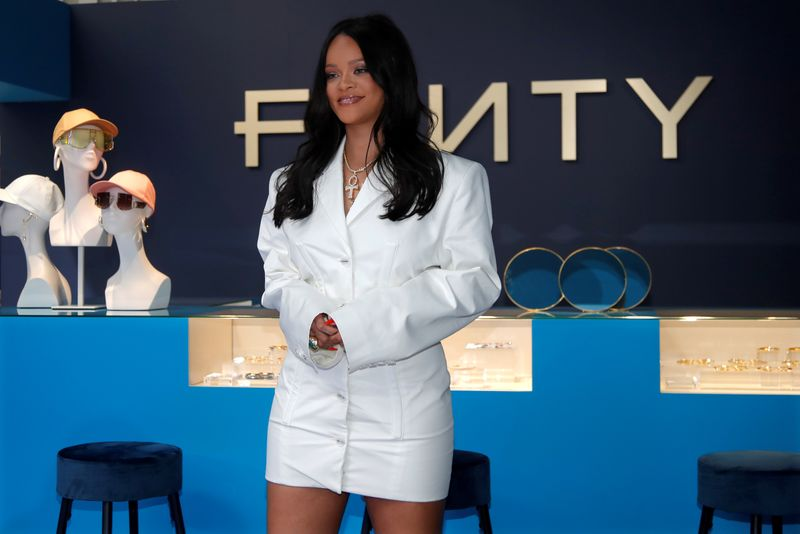 FILE PHOTO: Pop superstar Rihanna poses in a pop-up store to present her first collection with LVMH for the new label, Fenty, in Paris