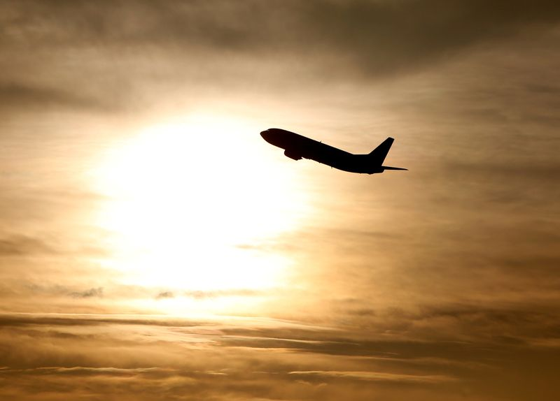 FILE PHOTO: A plane is seen during sunrise at the international airport in Munich
