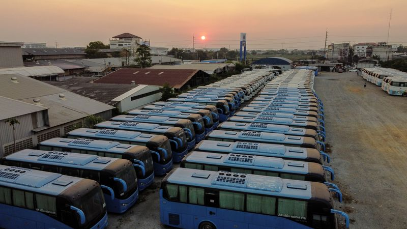 FILE PHOTO: Buses that used to transport Chinese tourists around Thailand are seen idle due to travel bans and border closures from the global coronavirus disease (COVID-19) outbreak in a parking lot near Suvarnabhumi airport in Bangkok, Thailand