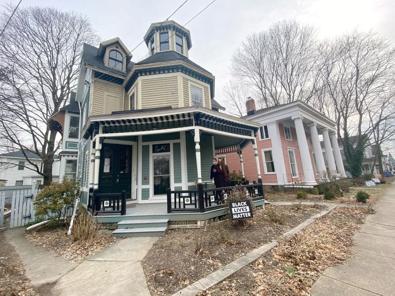 Kate and Cameron Reinhart stand at their 1880's Octagon house in eastern Connecticut