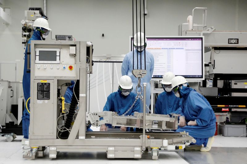 FILE PHOTO: Trainees learn how to build and operate an EUV machine at the training center at ASML Holding in Tainan,