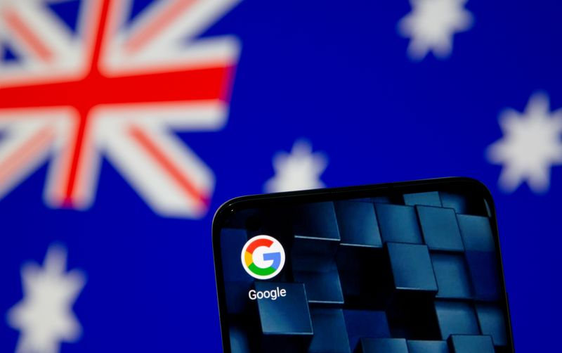 FILE PHOTO: A smartphone with a Google app icon is seen in front of the displayed Australian flag in this illustration