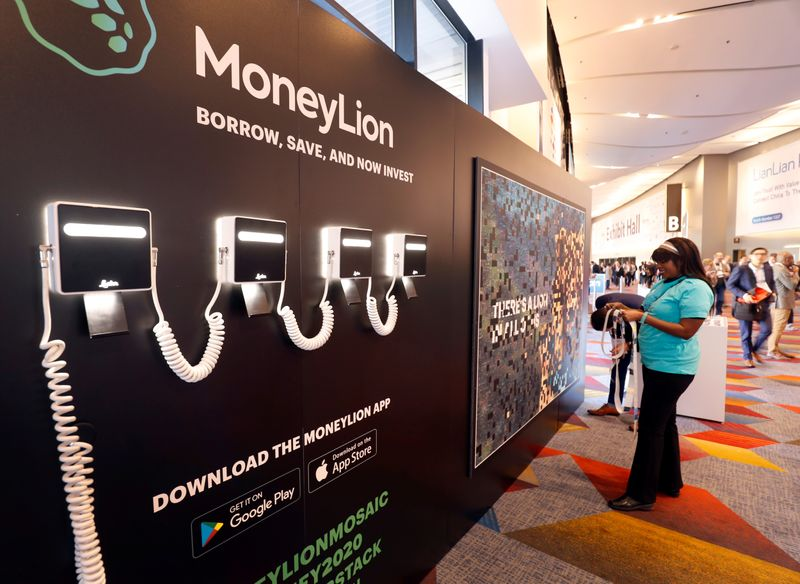 FILE PHOTO: MoneyLion, a digital consumer finance platform, displays in the lobby of the exhibit hall during the Money 20/20 conference in Las Vegas
