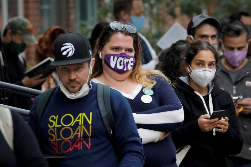 FILE PHOTO: Voters wait in line for several hours to cast their ballots during early voting in Brooklyn New York