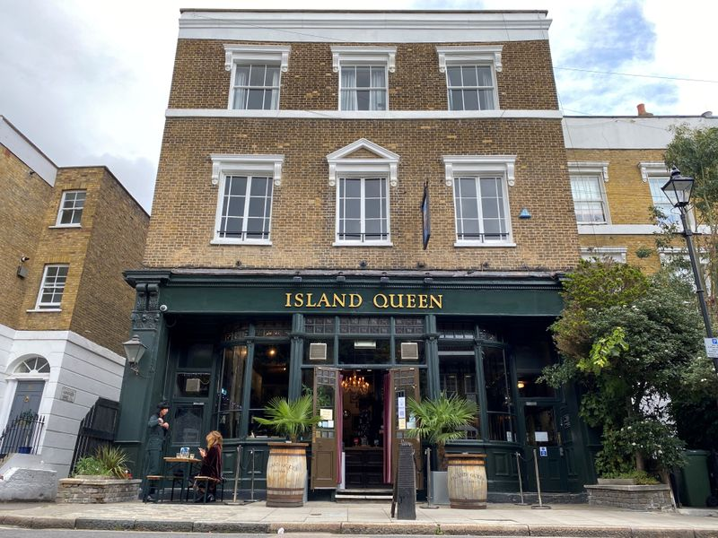 FILE PHOTO: Customers are seen at a table outside The Island Queen pub in London