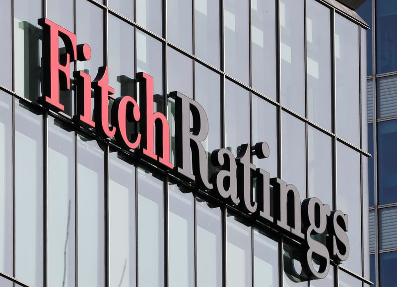 FILE PHOTO: The Fitch Ratings logo is seen at their offices at Canary Wharf financial district in London