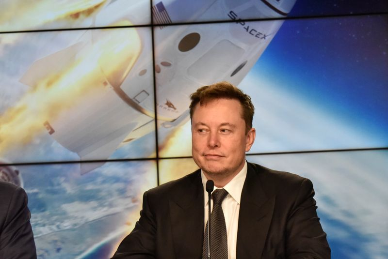 FILE PHOTO: SpaceX founder and chief engineer Elon Musk attends a news conference at the Kennedy Space Center